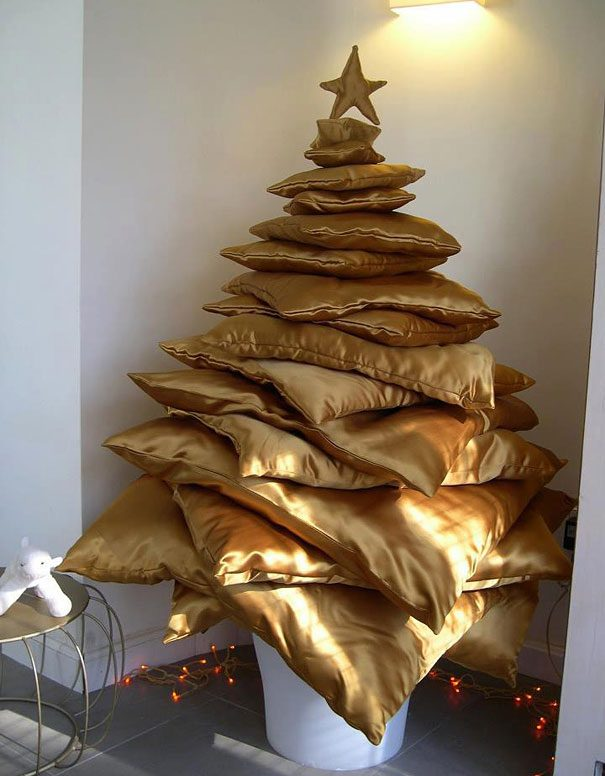A Unique Christmas Tree Made from Pillows | Want ideas for unique Christmas trees for the 2020 holiday season? Find inspiration ideas for your Christmas tree decoration from creative and unique xmas trees. From white, upside down, best Christmas trees on wall, pink Christmas trees, and even Disney Christmas tree decorations. From big and small unique Christmas tree ideas. Perfect for kids and for the holidays. #uniquechristmastree #christmastreeideas #christmastreeideas #christmas