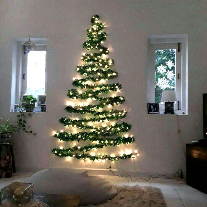 Christmas Tree Made on a Wall | Want ideas for unique Christmas trees for the 2020 holiday season? Find inspiration ideas for your Christmas tree decoration from creative and unique xmas trees. From white, upside down, best Christmas trees on wall, pink Christmas trees, and even Disney Christmas tree decorations. From big and small unique Christmas tree ideas. Perfect for kids and for the holidays. #uniquechristmastree #christmastreeideas #christmastreeideas #christmas