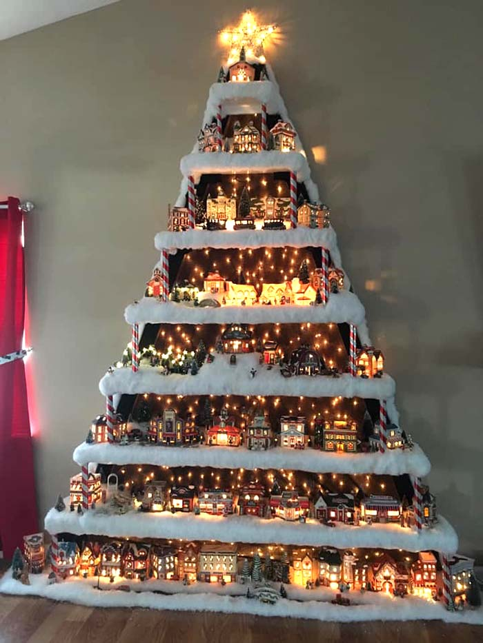 Layered Wall Christmas Tree | Want ideas for unique Christmas trees for the 2020 holiday season? Find inspiration ideas for your Christmas tree decoration from creative and unique xmas trees. From white, upside down, best Christmas trees on wall, pink Christmas trees, and even Disney Christmas tree decorations. From big and small unique Christmas tree ideas. Perfect for kids and for the holidays. #uniquechristmastree #christmastreeideas #christmastreeideas #christmas
