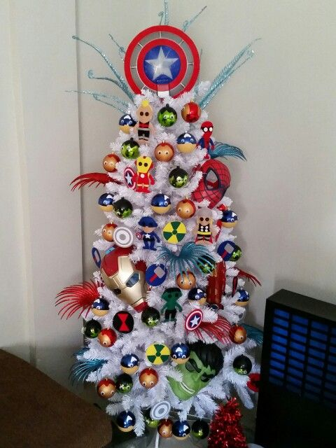 Unique Marvel-Themed Christmas Tree | Want ideas for unique Christmas trees for the 2020 holiday season? Find inspiration ideas for your Christmas tree decoration from creative and unique xmas trees. From white, upside down, best Christmas trees on wall, pink Christmas trees, and even Disney Christmas tree decorations. From big and small unique Christmas tree ideas. Perfect for kids and for the holidays. #uniquechristmastree #christmastreeideas #christmastreeideas #christmas