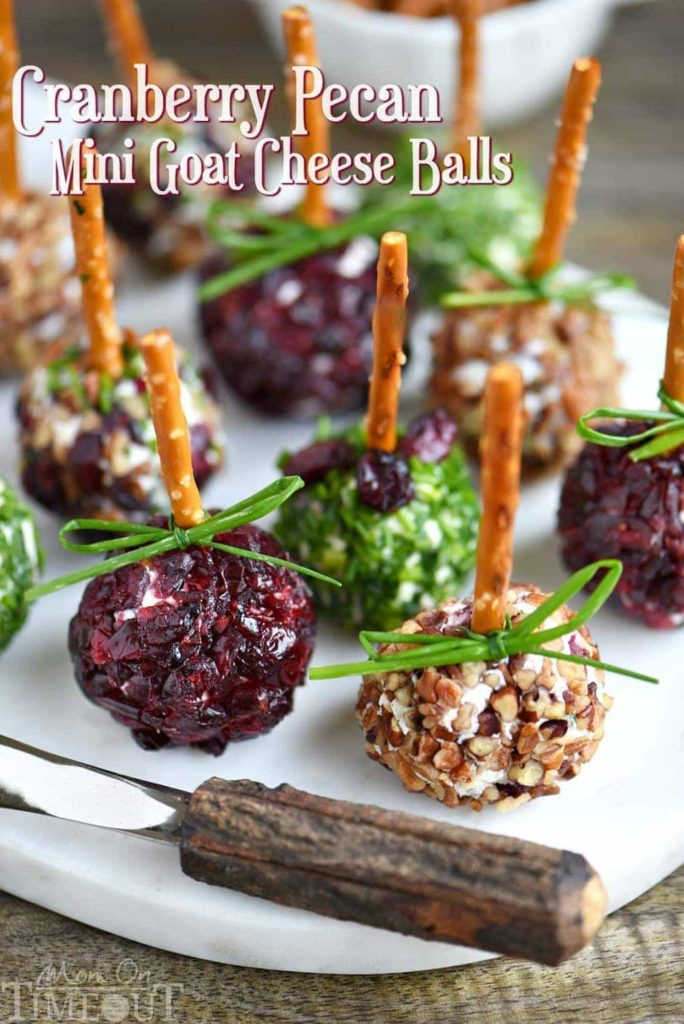 Mini Cranberry Goat Cheese Balls | Want to serve your guests the best Christmas party appetizers this year? Find a list of 40+ Christmas appetizers ideas & easy recipes for Christmas party appetizers, both sweet and savory holiday food. From elegant Christmas finger food ideas to easy dips, and simple crockpot holiday appetizers, (vegetarian, keto and even gluten-free appetizer ideas), perfect for a crowd and for kids. #christmaspartyappetizers #appetizersforchristmasparty #christmasparty #fingerfood #christmasfood