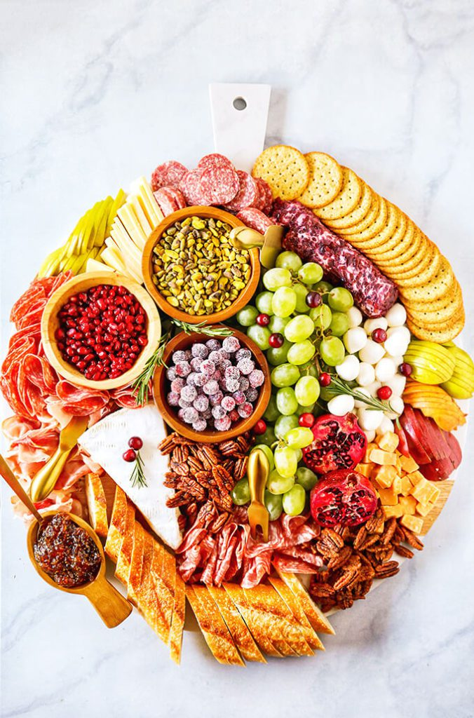 Holiday Charcuterie Board | Want to serve your guests the best Christmas party appetizers this year? Find a list of 40+ Christmas appetizers ideas & easy recipes for Christmas party appetizers, both sweet and savory holiday food. From elegant Christmas finger food ideas to easy dips, and simple crockpot holiday appetizers, (vegetarian, keto and even gluten-free appetizer ideas), perfect for a crowd and for kids. #christmaspartyappetizers #appetizersforchristmasparty #christmasparty #fingerfood #christmasfood