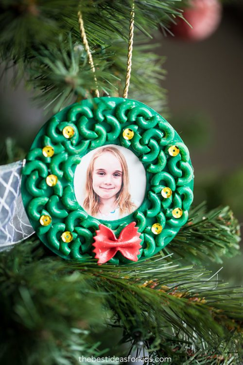 Pasta Christmas Ornaments with a girls' picture hanging from a Christmas tree