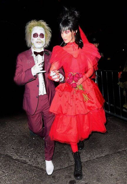 Beetlejuice and Lydia | Looking for iconic couples costume Halloween ideas for 2020? Find the best couples Halloween costume ideas, perfect for matching with your boyfriend. Find hot couples costume ideas, cool Disney characters costumes and the best DIY, funny, and scary couples Halloween costume inspiration. #CouplesCostumeHalloween #couplescostume #halloweencouples #halloween
