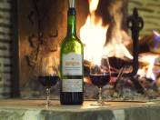 glass of wine by the open fireplace