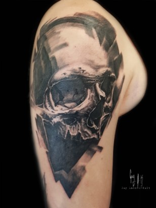 Charcoal style skull by Guy Labo-O-Kult done at Montreux Tattoo Show, 2018