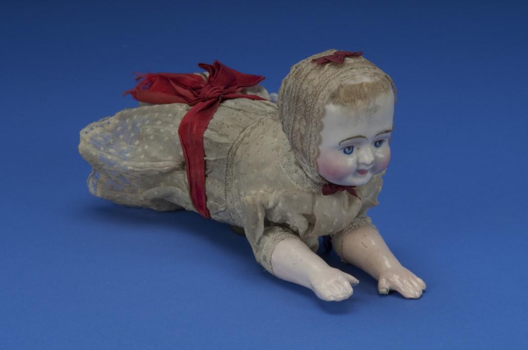 "Automaton.  Mechanical doll, ""The Wonderful Creeping Baby"".  2011.0204.01a."