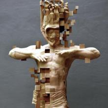 Des glitchs sur des statues de bois
