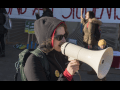 Woman on megaphone supporting Oakland teachers and students during Oakland teacher strike.