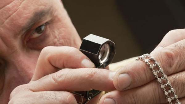 gemologist inspecting jewelry