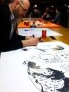 Luís Bustos dibujando su dedicatoria para Whakoom
