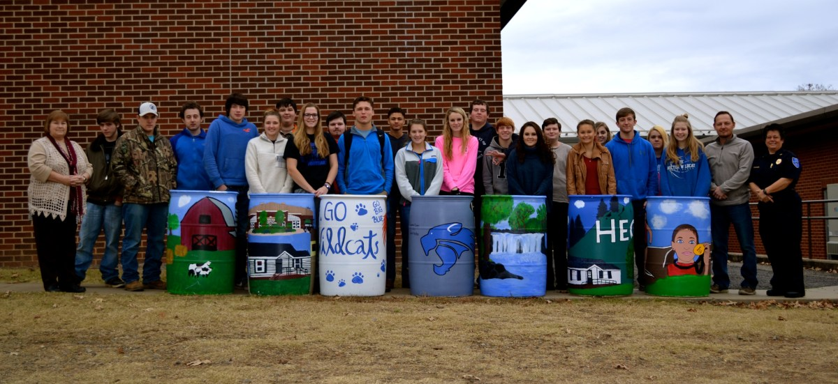 Art Class Presents Painted Trash Cans to Mayor Riley for City of Hector