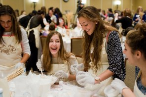 Girls mix challah dough at the Mega Challah Bake in Potomac, Maryland, which was attended by more than 500 Jewish women.