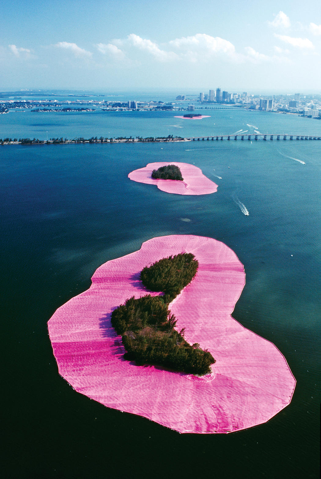 Christo and Jeanne-Claude  Surrounded Islands, Biscayne Bay, Greater Miami, Florida, 1980-83  Photo: Wolfgang Volz  © 1983 Christo