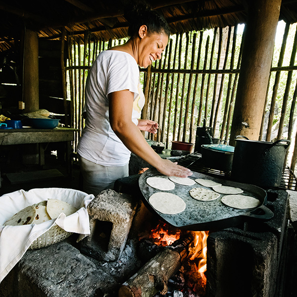 Woman cooking bread