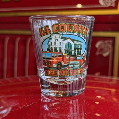 Shot glass with an image of the Museum and the 51s, Engine and Squad, in front