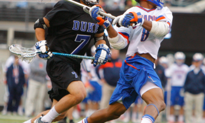 Apr 1, 2012; East Rutherford, NJ, USA; Syracuse Orange midfielder Hakeem Lecky (8) opens the game with a goal against Duke Blue Devils midfielder Jake Tripucka (7) at the Big City Classic at MetLife Stadium. Mandatory Credit: Jim O'Connor-US PRESSWIRE