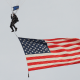 July 6, 2012; Boston, MA, USA; A member of the Navy Seal Leap Frog's gets ready to land at Fenway Park prior to a game between the Boston Red Sox and New York Yankees. Mandatory Credit: Bob DeChiara-US PRESSWIRE