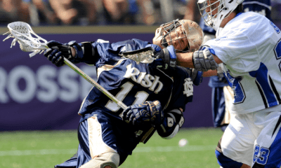 May 31, 2010; Baltimore, MD, USA; Notre Dame defenseman Neal Hicks (11) gets cross checked by Duke midfielder Sam Solie (23) during the first half of the 2010 NCAA Division I Lacrosse Championship at M&T Bank Stadium. Mandatory Credit: Rafael Suanes-US PRESSWIRE