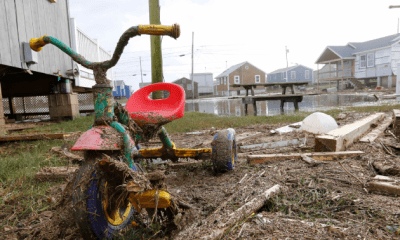 Oct 30, 2012; South Kingstown, RI, USA; A child's bike is covered in debris at the Roy Carpenter's Beach cottages from Hurricane Sandy. Mandatory Credit: Greg M. Cooper-US PRESSWIRE
