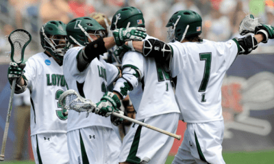 May 26, 2012; Boston, MA, USA; Loyola Maryland Greyhounds midfielder Davis Butts (7) celebrates a goal with his teammates during the first half of the NCAA Division I semifinals against the Notre Dame Fighting Irish at Gillette Stadium. Mandatory Credit: Bob DeChiara-USA TODAY Sports