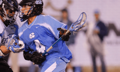 Apr 1, 2012; East Rutherford, NJ, USA; North Carolina Tar Heels attack Jimmy Bitter (4) works against the John Hopkins Blue Jays at the Big City Classic at MetLife Stadium. North Carolina Tar Heels defeat the John Hopkins Blue Jays 13-9. Mandatory Credit: Jim O'Connor-USA TODAY Sports
