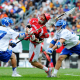 May 25, 2013; Philadelphia, PA, USA; Cornell Big Red midfielder Max Van Bourgondien (center) is double teamed by Duke Blue Devils defenseman Henry Lobb (77) and midfielder David Lawson (right) during the first quarter of the 2013 NCAA Division I men's lacrosse semifinals at Lincoln Financial Field. Mandatory Credit: Rich Barnes-USA TODAY Sports