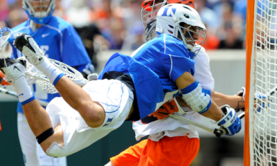 May 27, 2013; Philadelphia, PA, USA; Duke Blue Devils midfielder Jake Tripucka (7) takes a diving shot into Syracuse Orange goalie Dominic Lamolinara (50) during the second quarter of the 2013 NCAA Division I Men's Lacrosse Championship Game at Lincoln Financial Field. Mandatory Credit: Rich Barnes-USA TODAY Sports