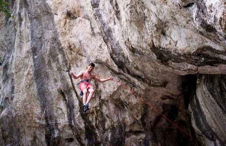 Jernej Kruder climbs a trad-style Umazana igra (8b +)