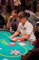 casino dealer preparing game