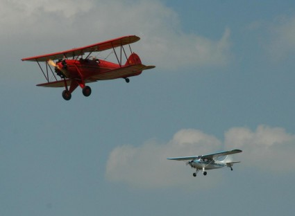 Susan leading in her RNF Waco trailed by Judy in the Champ