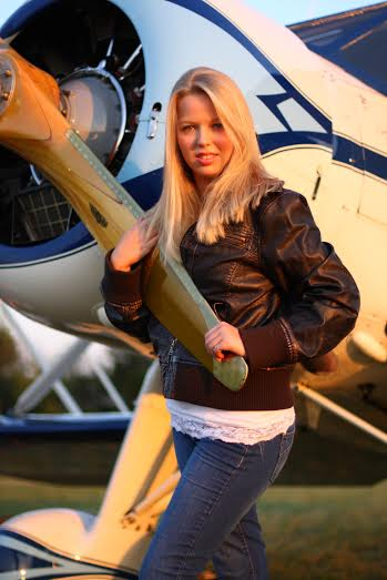 with the family plane, a 1936 Cabin Waco. It was one of my senior pictures a couple years ago. I must admit, I do not fly the Waco unless it is already in the air, and under my dad's very careful supervision.