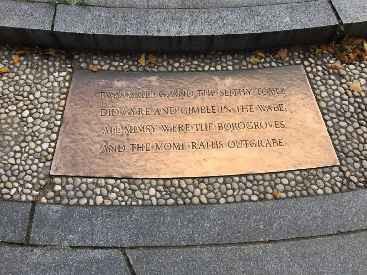 One of the plaques surrounding the Alice in Wonderland statue