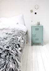 http://www.remodelista.com/posts/five-favorites-angled-wooden-headboards-high-low/