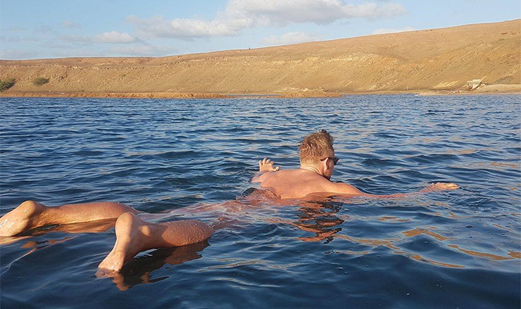 Lee Walpole floating in the salt lake in Cape Verde