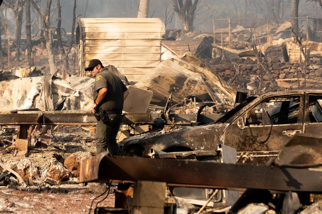 Dozens of homes burn as California wildfire siege continues
