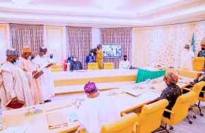 Buhari swears in three INEC commissioners