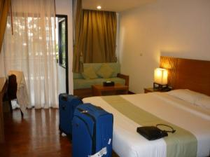 Areca Lodge bedroom with sofa and balcony