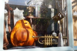 Close up of trumpet playing pumpkin in window at 20th Century Music Company | Photo credit: Krista