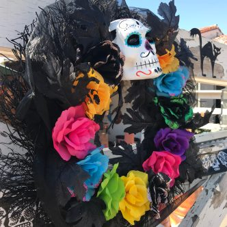 Day of the Dead wreath on the fence outside El Centro Artesano in Old Town. | Photo credit: Krista