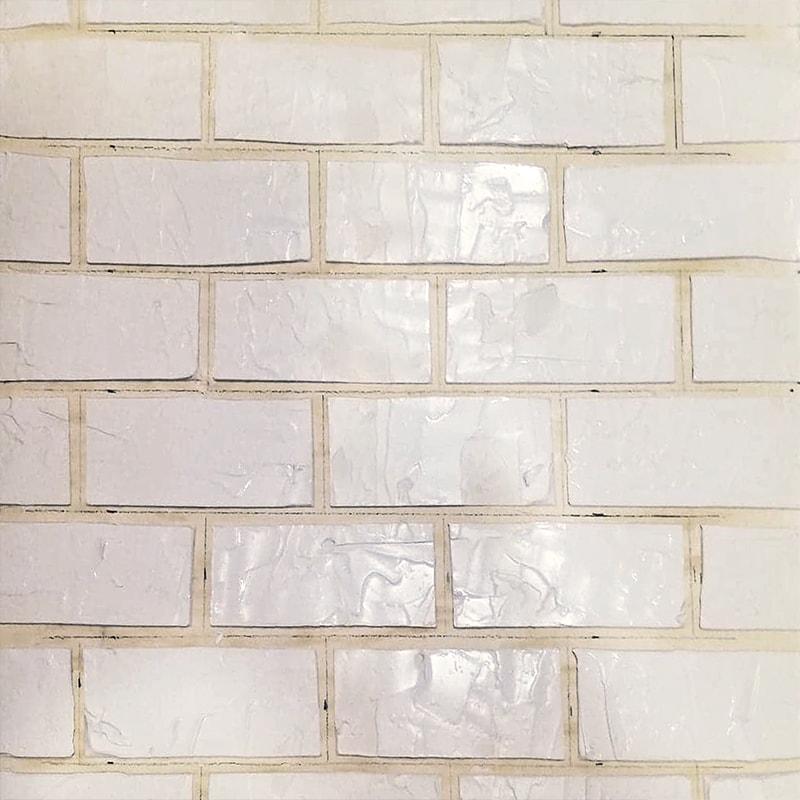 réalisation des fausses briques avec l'enduit
