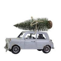petite voiture bleue avec sapin sur le toit pour décorer à noël