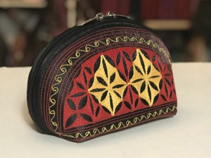 tari large handmade cosmetic bag in black red and yellow embroidery by Laga
