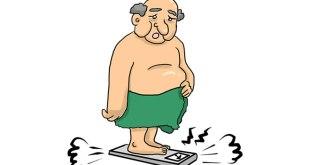Uomo grasso sulla bilancia