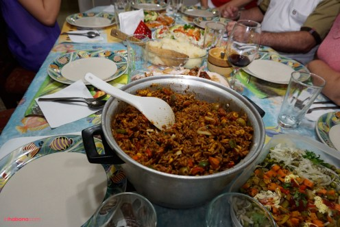 Cuban family holiday dinner with a cacerole of rice and salads