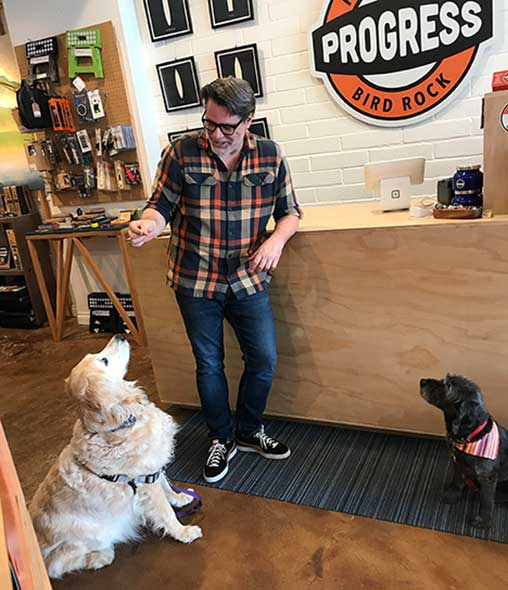 Dog with owner of Progress in La Jolla