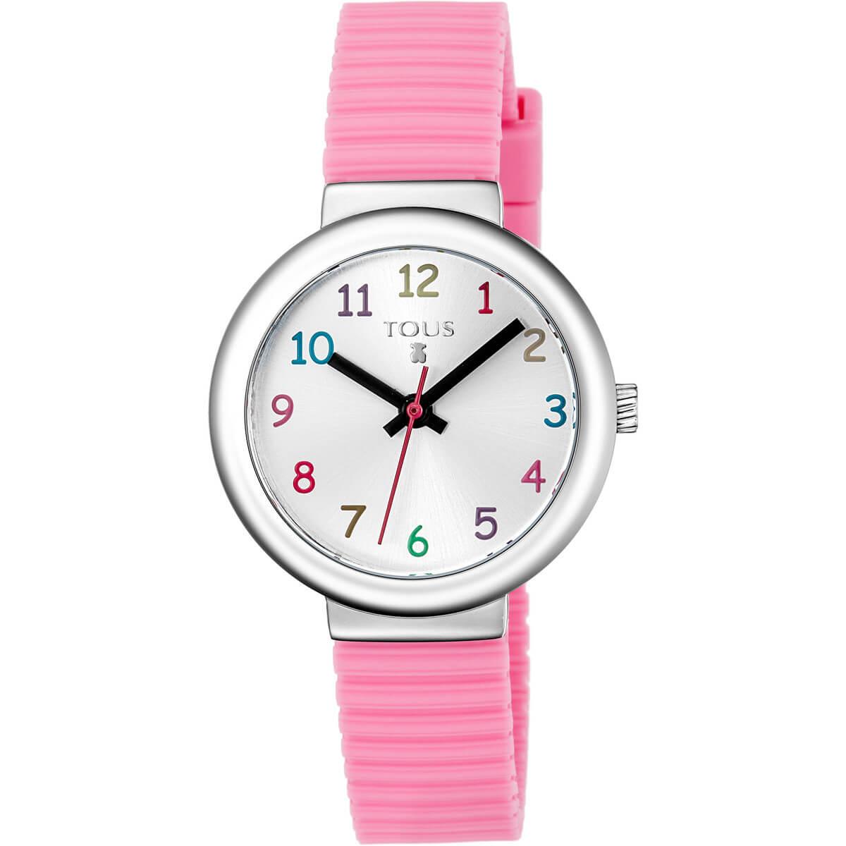 Reloj tous niña con correa de caucho rosa, esfera en color plata y indices de colores. diametro de la caja de 29 mm