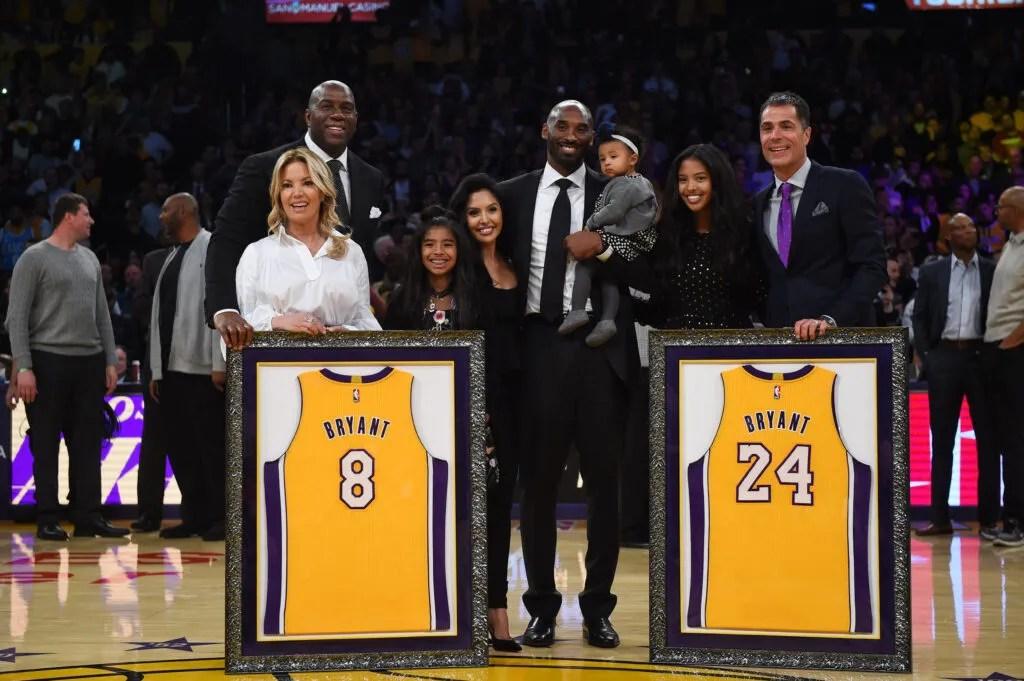 Kobe Bryant, Jeanie Buss, Magic Johnson, Rob Pelinka and his family at Staples Center