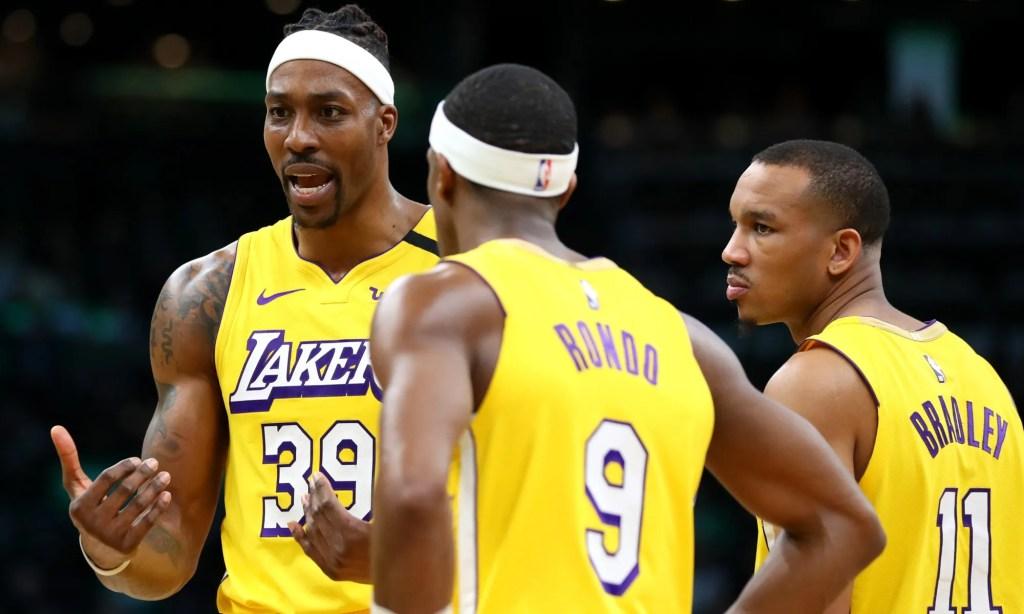 Dwight Howard, Rajon Rondo and Avery Bradley. Los Angeles Lakers vs Boston Celtics at TD Garden