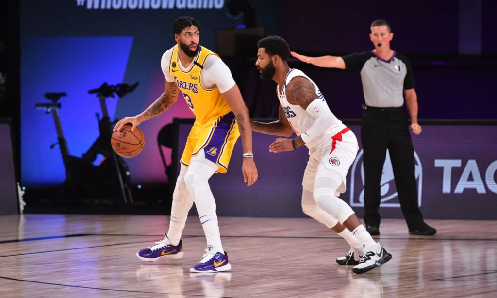 Orlando, FL - JULY 30: Anthony Davis #3 of the Los Angeles Lakers handles the ball against the LA Clippers on July 30, 2020 at The Arena at ESPN Wide World Of Sports Complex in Orlando, Florida. NOTE TO USER: User expressly acknowledges and agrees that, by downloading and/or using this Photograph, user is consenting to the terms and conditions of the Getty Images License Agreement. Mandatory Copyright Notice: Copyright 2020 NBAE